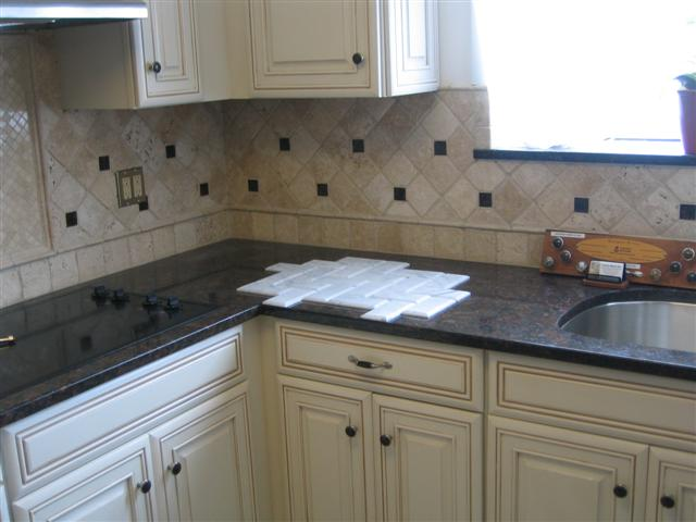Cabinet knobs and tile can accentuate the counter tops.