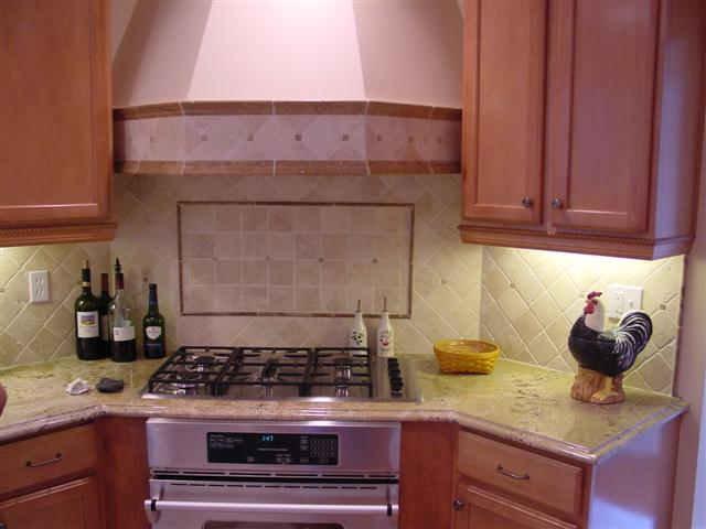 Backsplash Inlays frame tumbled tiles. Luxury Stone Kitchen